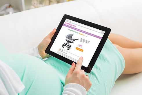 Pregnant woman shopping online on baby s