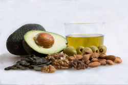 stock-photo-healthy-fat-with-avocado-olive-oil-pumpkin-seed-almond-olive-and-walnut-436784551