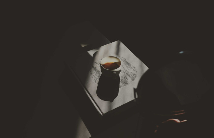 coffee-cup-on-coffee-tabel-book.jpg
