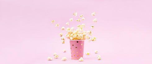 Flying Popcorn in a bright glass and on