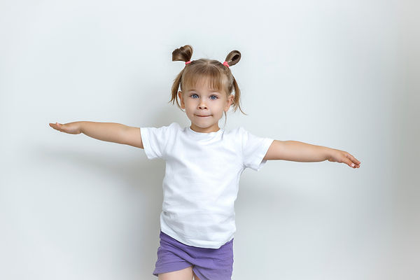a cute girl 4 years old in a white t-shi