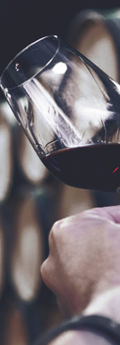 closeup-hand-with-glass-red-wine-backgro