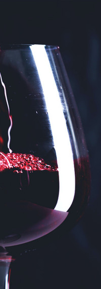 2pouring-red-wine-into-glass_93675-23625