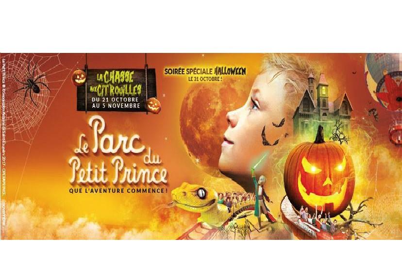Le Petit Prince est entouré d'une toile renseignée, d'une citrouille, d'un ballon à air, d'une maison hantée et d'une attraction qui a l'apparence d'un serpent