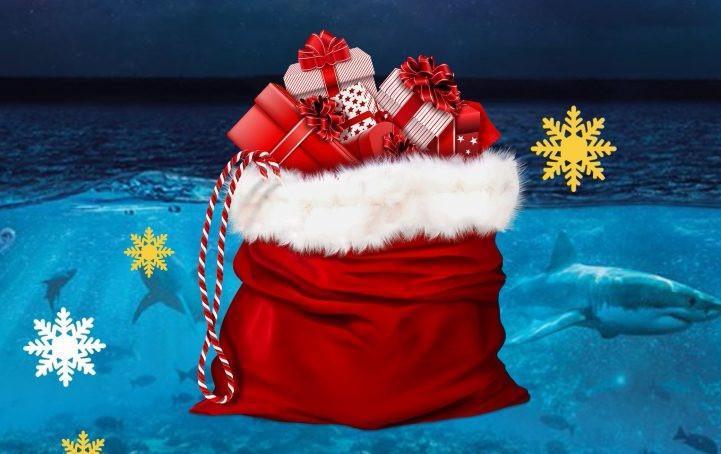 Hôte du Père Noël dans un aquairum