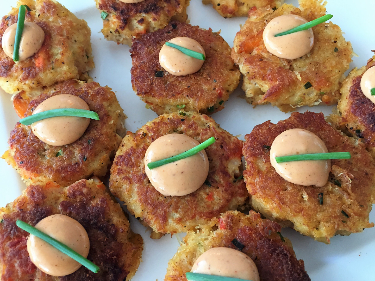 Crab cakes and red pepper crema.JPG