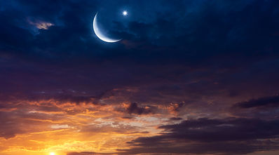 Crescent moon with beautiful sunset back