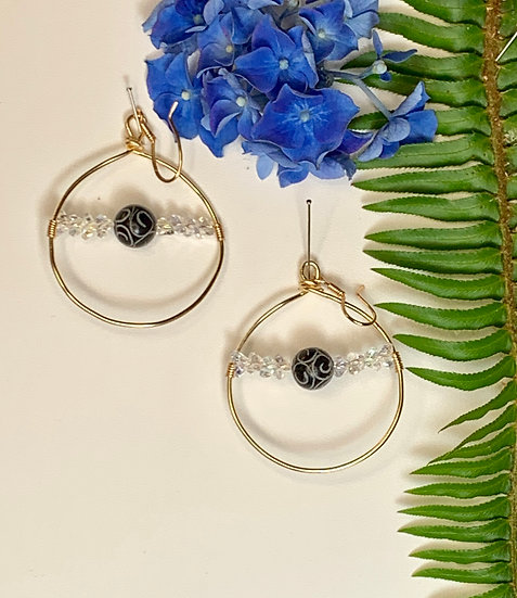 Gold hoop earrings with beaded accents