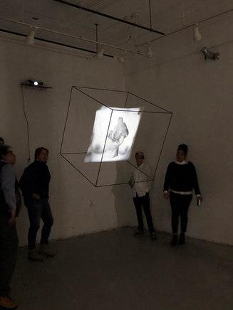 Sigh/ Swell, 2018, steel, monofilament, silkscreen on cotton, video projection, 3x3x3'