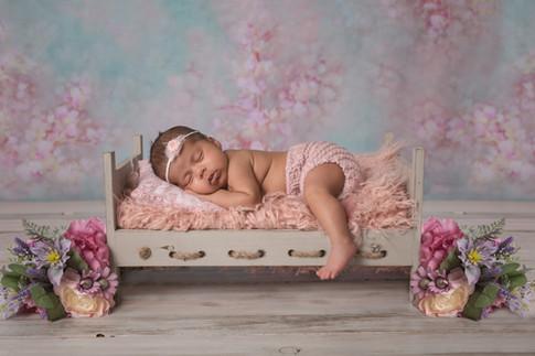 newborn photo baby sleeping in bed