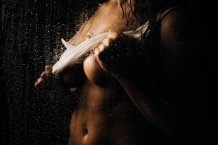 Woman in shower lifting up on White shirt