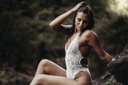 Brunette in White lingerie sitting on a rock in Tuscaloosa AL
