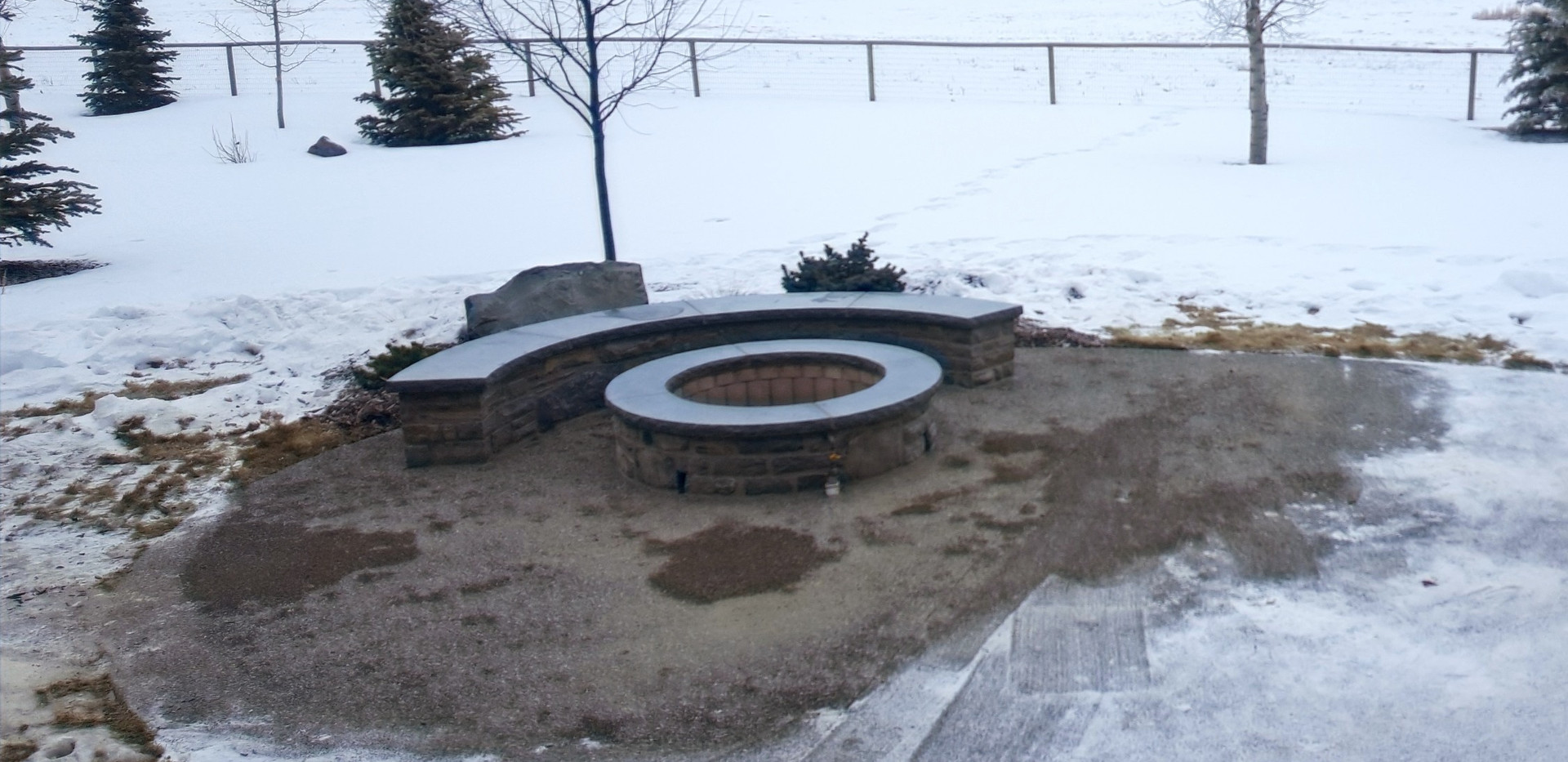 Firepit and curved stone bench