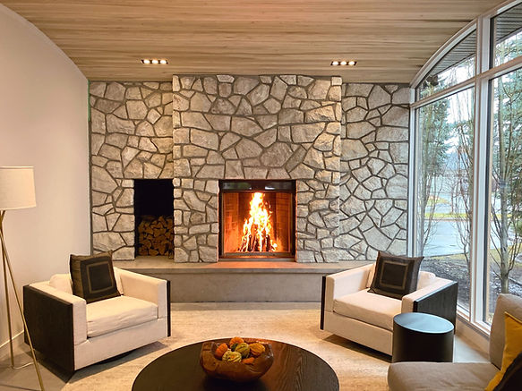 Rebuilt Indoor Fireplace with wood storage by LMent Stone