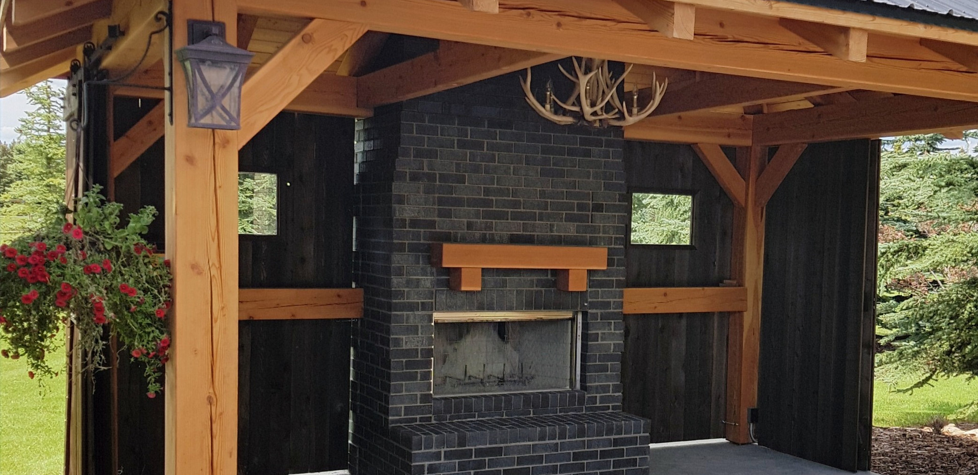 black brick outdoor fireplace