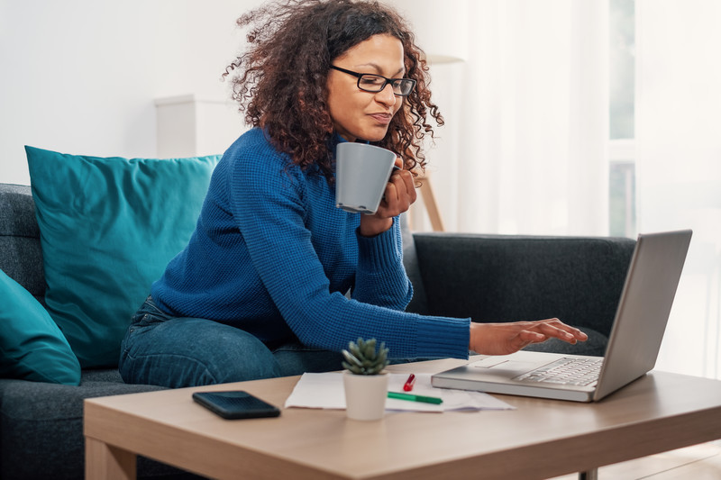Woman researching for her homeshare rent to charge a roommate for shared living, photo supplied by HomeShare Alliance