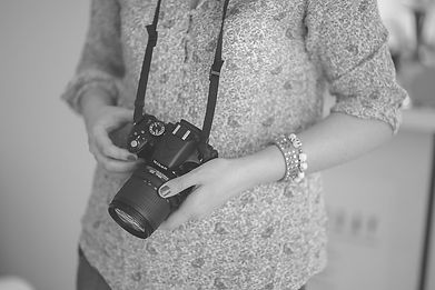 Canva - Female photographer holding a ds