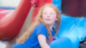 Girl playing in the bounce house