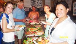 Enjoying food cooked underground