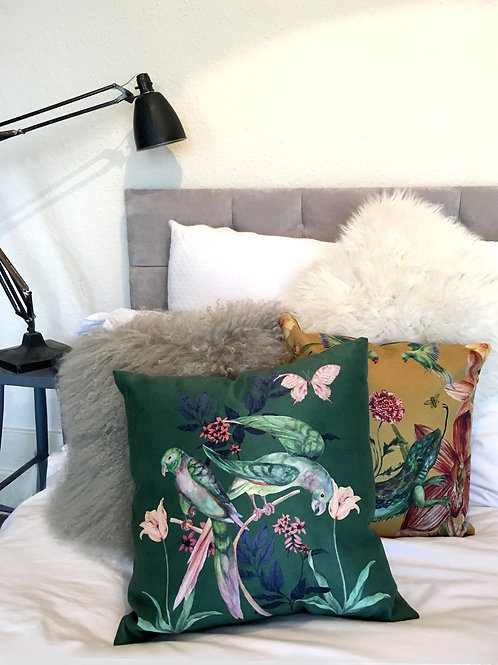 Forest green and blush pink 'Plumage' Cushion with parrot design, vegan suede
