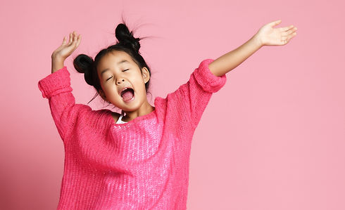 Asian kid girl in pink sweater, white pa