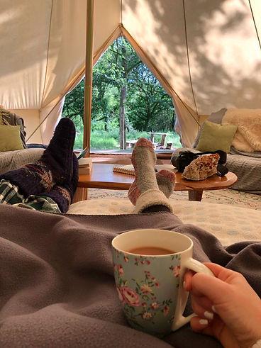 feet up, enjoying a cuppa at Just Us Retreats