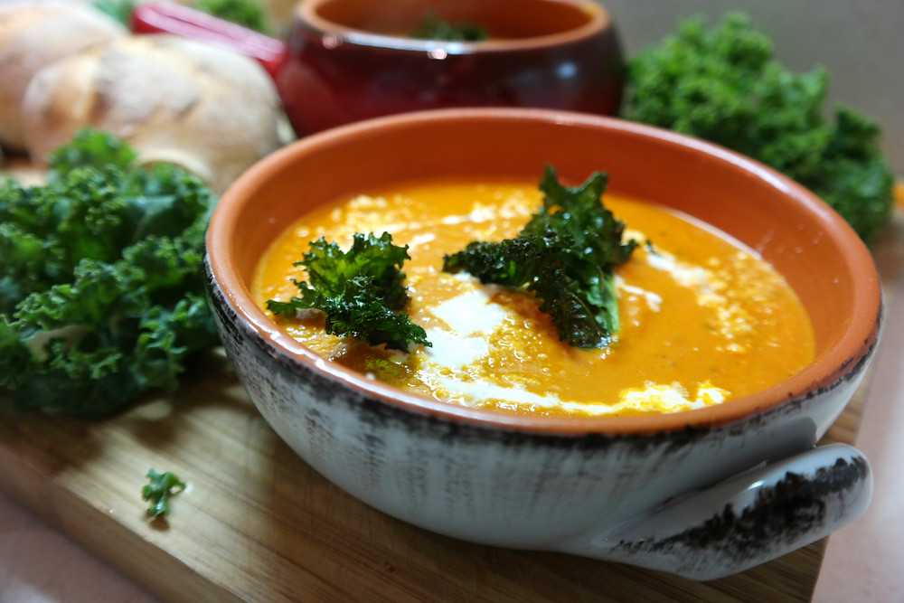 Cozy Tomato Soup, topped with Peppered Kale Chips | eatlovegarlic.com @eatlovegarlic