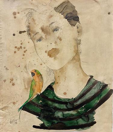 VALE-Giovane con piccolo pappagallo-80x9