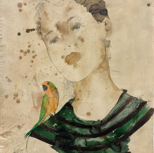 Young man with small parrot