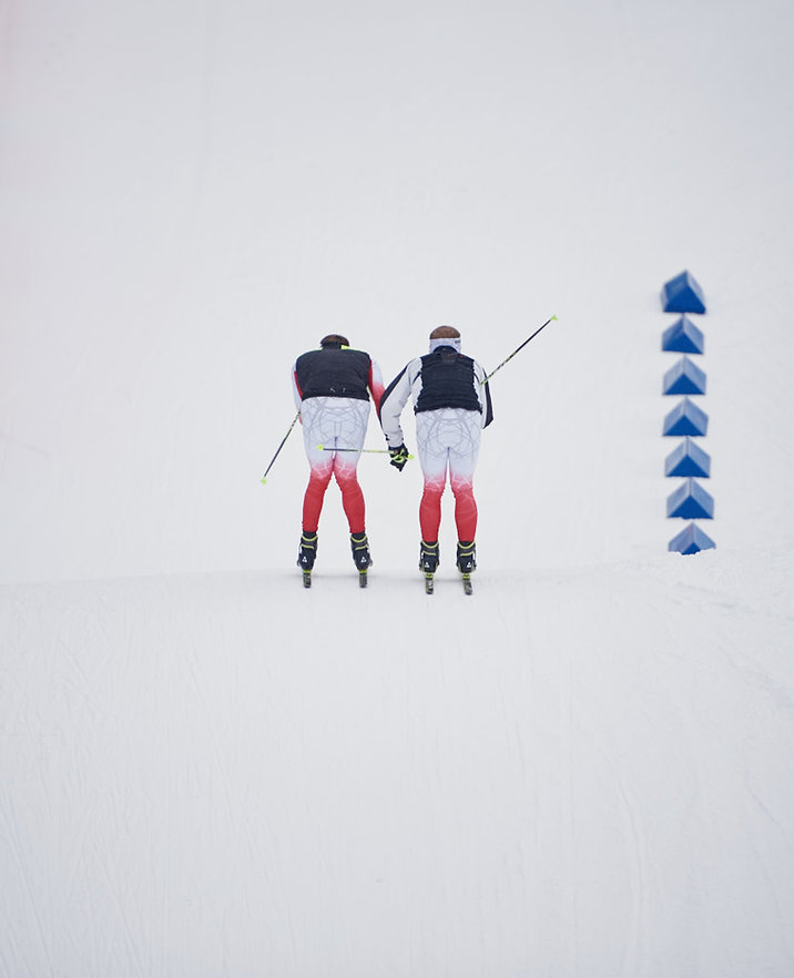 Biathlon sport Fotografie, sport photography on the Biathlon world cup. Two wax men testing skis at the World championships in Oslo