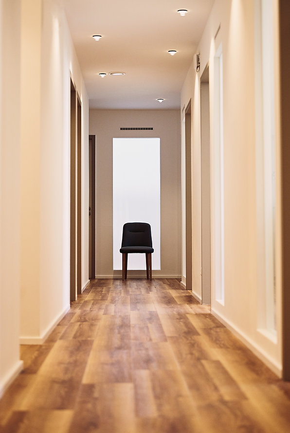 image with chair at end of corridor. Photography of high end and prestigious interiors