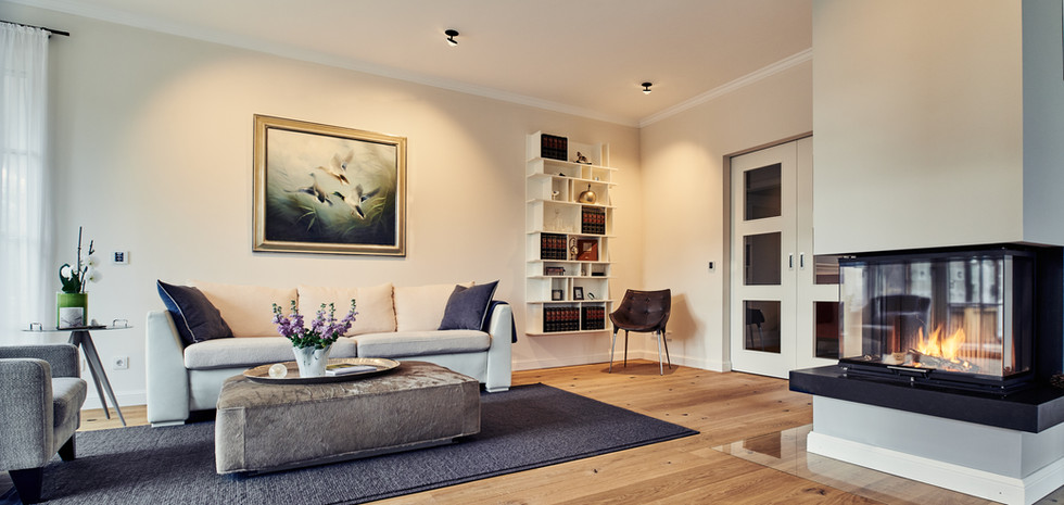 Living room design with fireplace and lighting from Heimatlicht