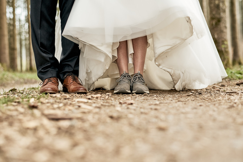 Feet of bride and groom during portrait session