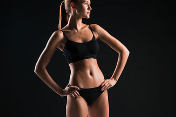 muscular-young-woman-athlete-on-black.jp