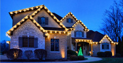 """<img src=""""lights.png"""" alt=""""roof top of house trimmed in holiday lights"""">"""