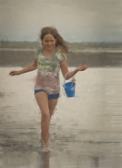 Young girl running through the tide