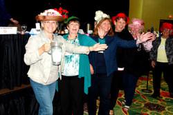 Volunteers showing off their hats!