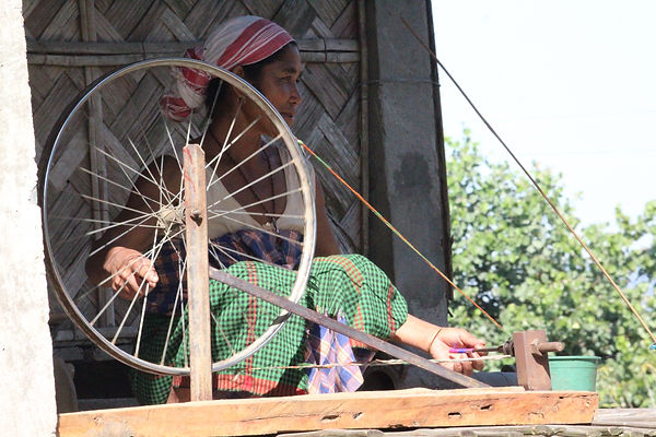 a woman spinning outside her home