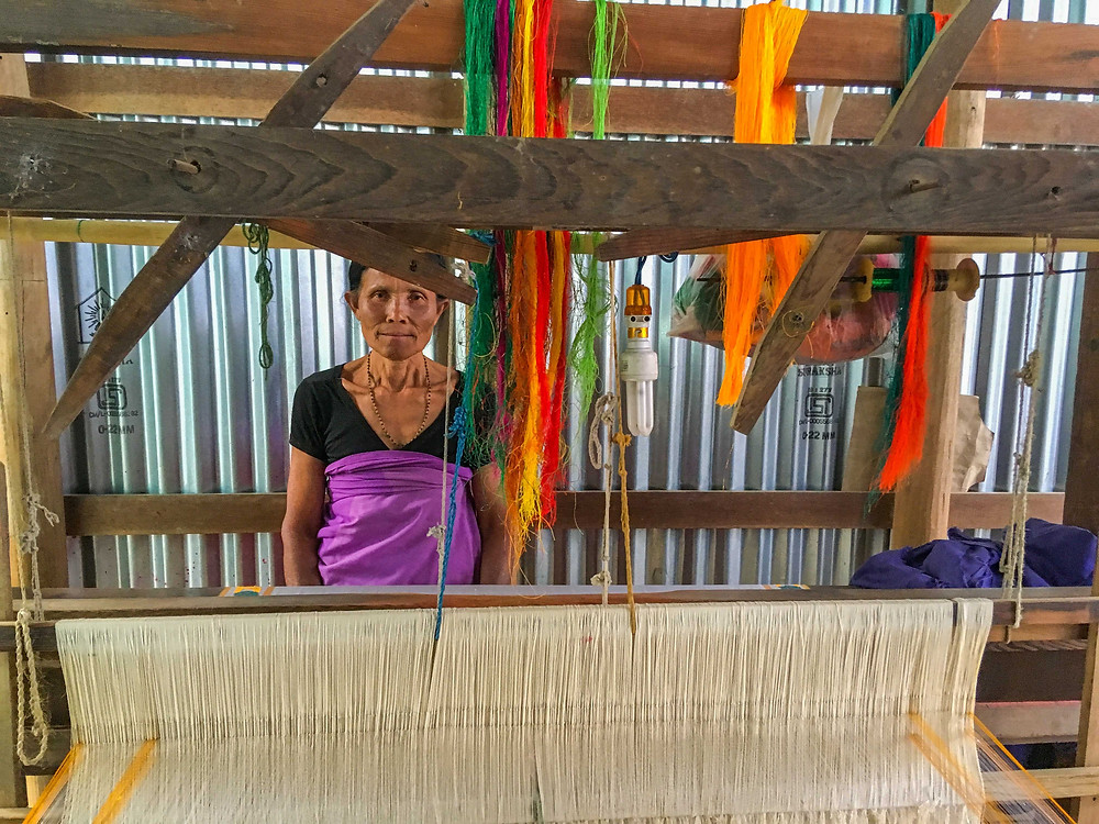 A weaver at her loom