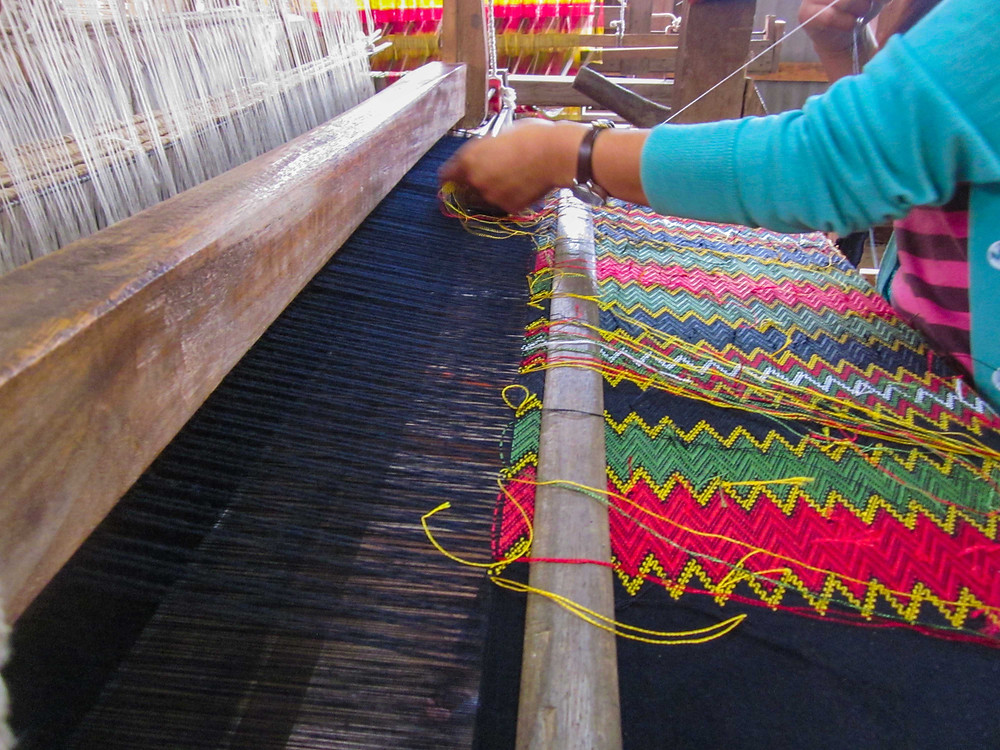 As the weaving progresses the intricate patterns and colours come to life