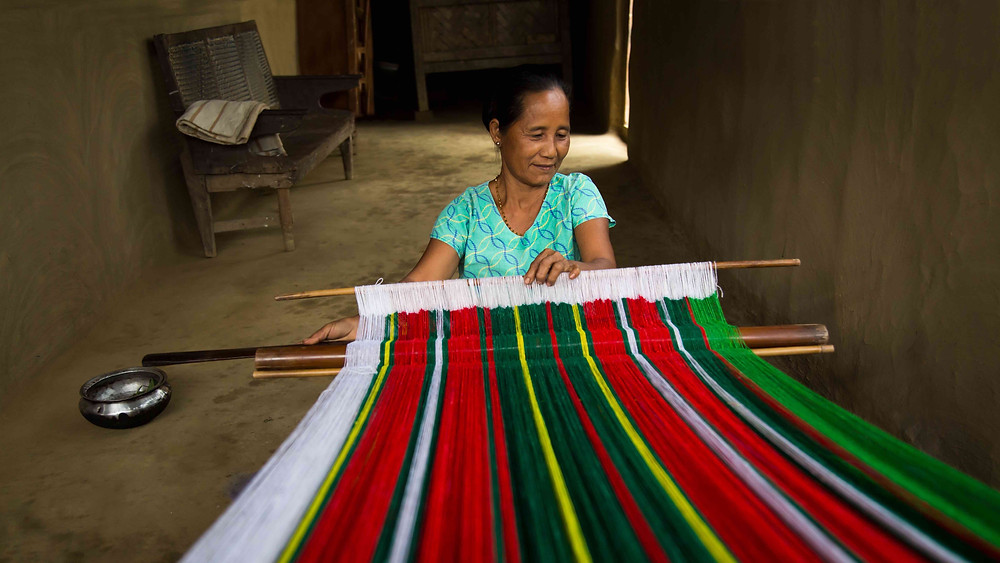 Setting up her loom to do her weaving for the day