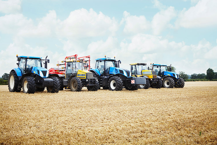 Banner Image with small tractors lined up in an open field to represent the agriculture and turf care industry of Reliable Autotech