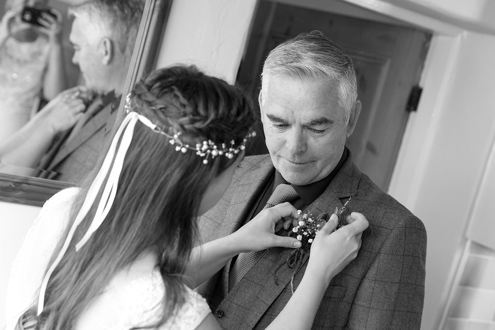 black & white photo of the bride & her father