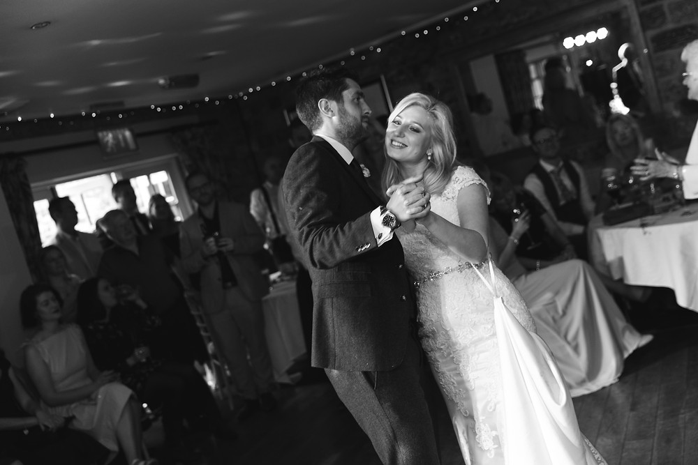 The bride and groom doing the first dance