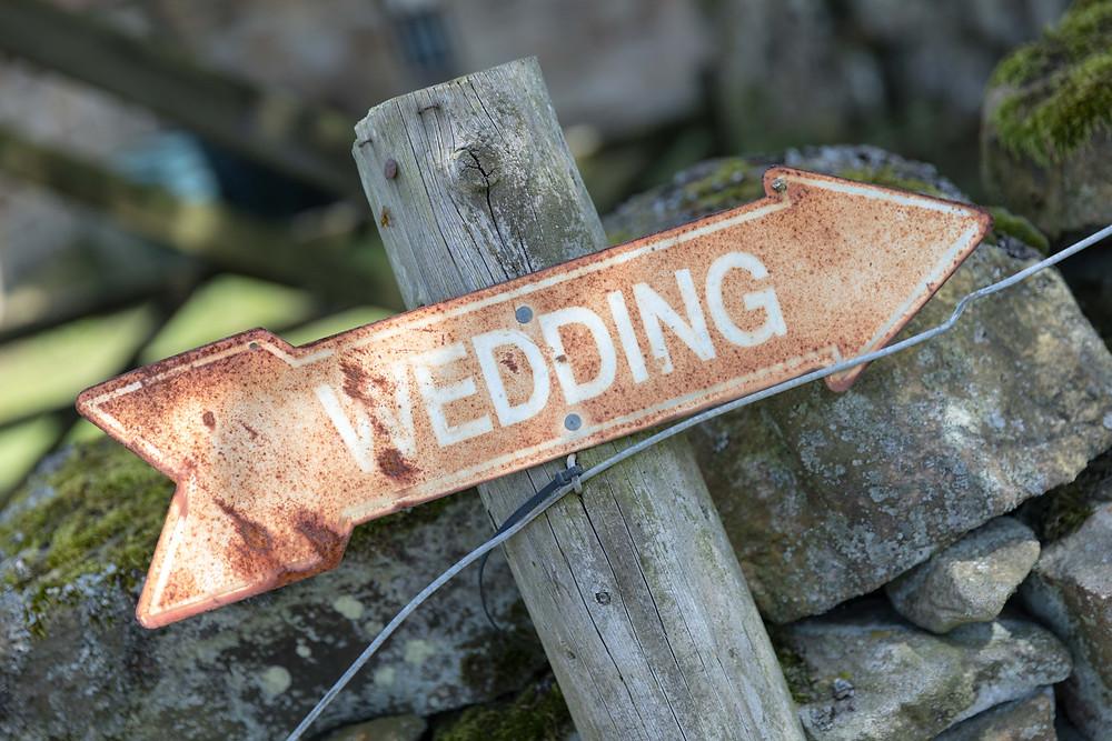 reportage wedding photograph of wedding sign