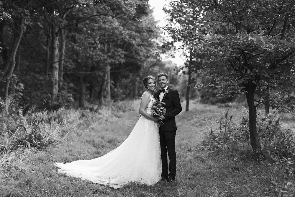 Black and white wedding portrait of the happy couple