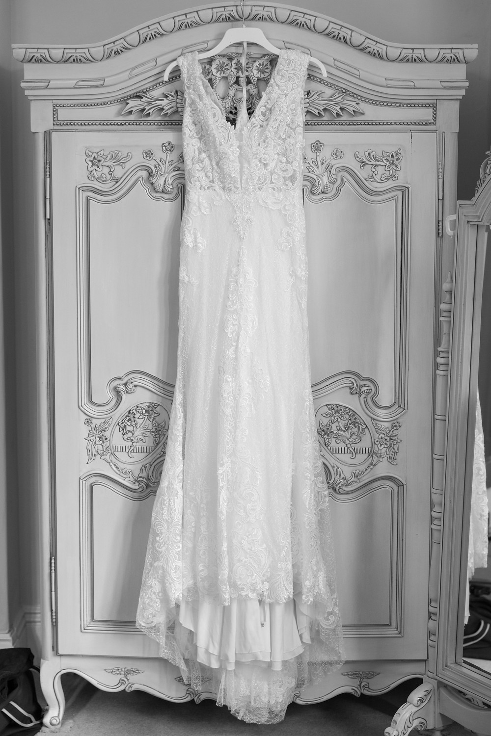 wedding photograph of brides dress hanging