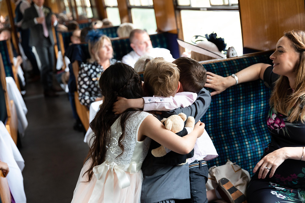Wedding guests enjoying the train journey