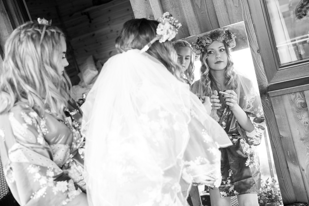 An image of the bride doing her make up by North Yorkshire wedding photographer