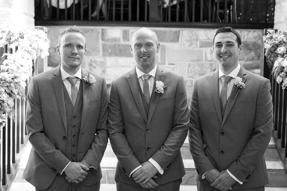 Black & white shot of the groom and best man